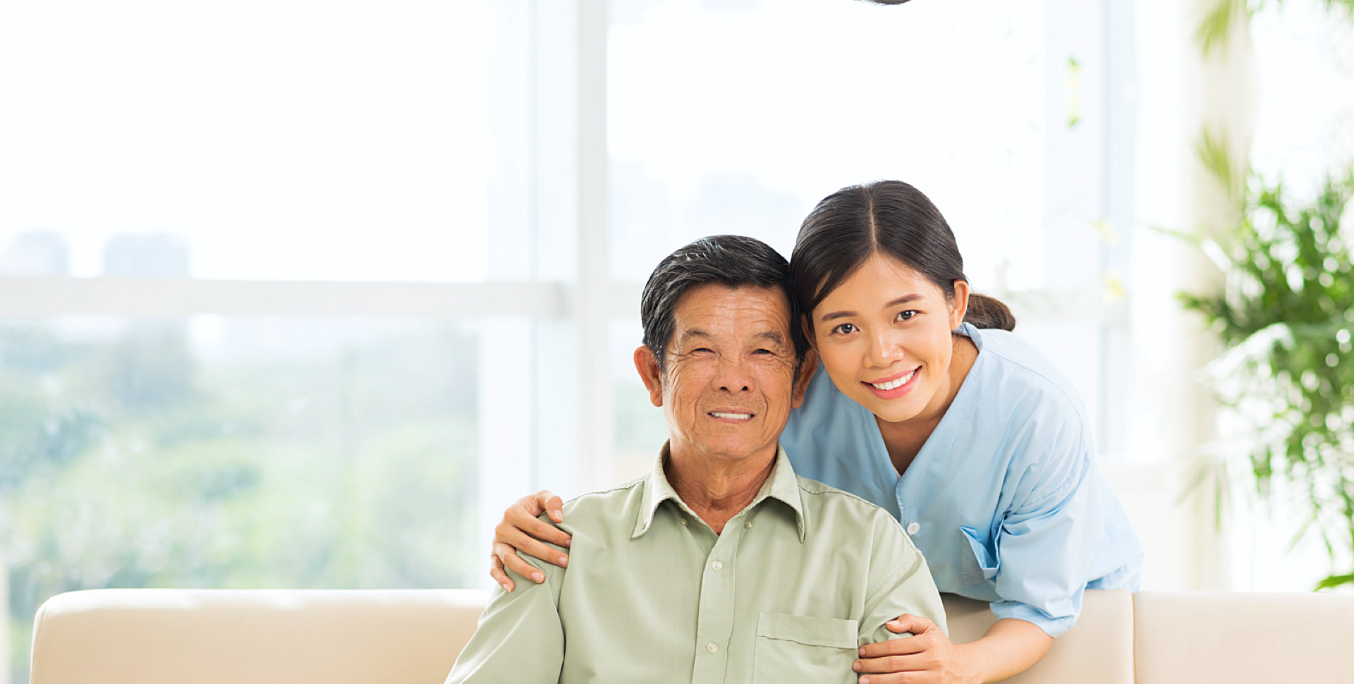 female caregiver and her old man patient smiling